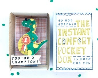 Dino - The Instant Comfort Pocket Box - you're a champion! - cheer up and consolation box - achievement gift