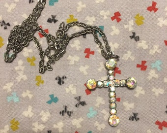 Iridescent silver tone cross necklace