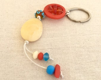 Key chain key ring assorted cream, orange and blue resin and lampwork glass beads on cream cotton cord bag bling gift for her