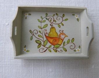 12th scale dollhouse miniature  handpainted tray  with a folk art  yellow orange bird and a pear tree in a antique white/grey background
