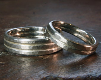 Pair of recycled sterling silver textured double band wedding rings. Hand made in the UK.