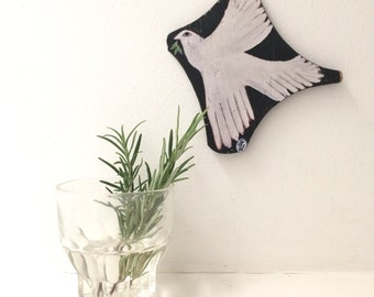 Print on laser cut wood from an original painting of a dove.