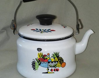 Vintage enamelware teapot with lid and handle.