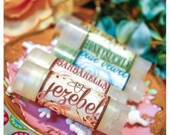 jezebel - mai tai flavored lip embellishment - housed in nifty frosted dispenser