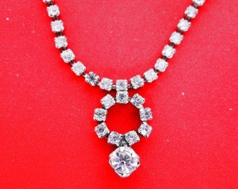 Vintage 1950s rhinestone necklace with circle center  in great condition