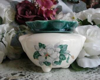 Magnolias and Emerald Green Ruffles Adorn this Tiny Violet Pot