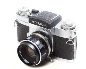 Miranda 35mm SLR camera with waist level finder and 50 or 135mm lens