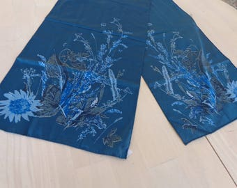 Long Teal Scarf by Vera _ Long Teal Blue flowered scarf  Polyester with tag  Size is 52 x 11 1/2 inches