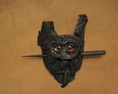 Grichels leather hair thing stick barrette - black with custom metallic red slit pupil eyes
