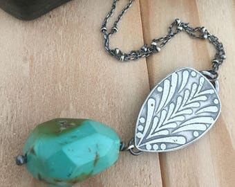Large earthy sea blue-green turquoise focal bead and modern pattern sterling silver tear drop pendant and a patinated satellite chain.