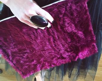 Burgundy fur clutch bag with contrast zip