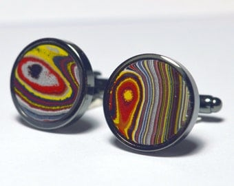 Cufflinks with fordite insert and epoxy resin coating