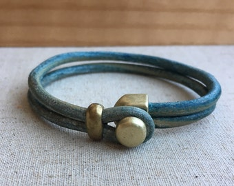 LEATHER CUFF bracelet. TEAL/tuquoise distressed leather with antique brass button clasp.