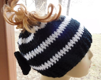 Crocheted Messy Bun/ Ponytail Beanie in Black with White Stripes and Attached Black Bow