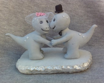 Dinosaur bride and groom weddng cake topper