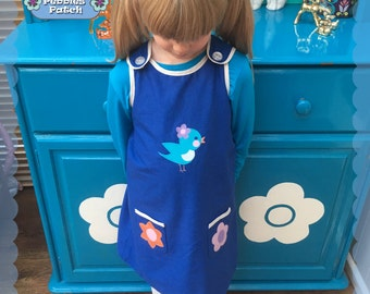 Sweet girls' Blue Bird' blue pinafore dress with applique birdie and flower pockets, vintage / retro style
