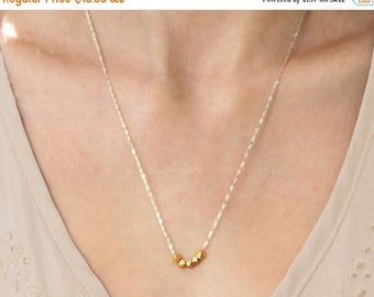 20% off. Tiny nuggets of gold on a silver chain necklace