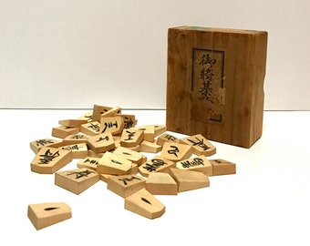 Antique Japanese Chess Shogi Koma Game pieces in Paulownia wood box, 41 pieces, hand carved and lacquered characters