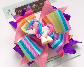 "Unicorn Bow, Unicorn hair bow -- Rainbow ribbons with custom clay unicorn center -- choose 4-5"" or 6"" bow"