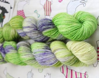 """Hand dyed sock yarn. 50gms. Superwash wool and nylon blend. Purple and green """"Bluebells"""" colourway."""