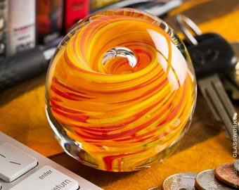 Small Round Art Glass Paperweight - Red Orange and Yellow Streaks with Bubble
