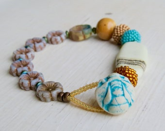 Bumble On - handmade turquoise, honey yellow and white bumblebee bead bracelet with artisan beads and handwoven glass - Songbead UK