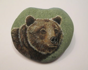 Grizzly Bear hand painted on a rock by Ann Kelly