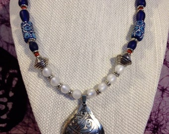 African inspired Trade Bead Necklace With Silver Moroccan Engraved Pendant
