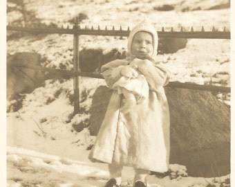 """Vintage Snapshot """"Snow Baby"""" Adorable Little Girl Baby Doll Knit Hat Snow Winter Doll Photo 1914 Found Photo"""