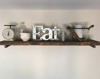 Shelf made from salvaged barn wood.