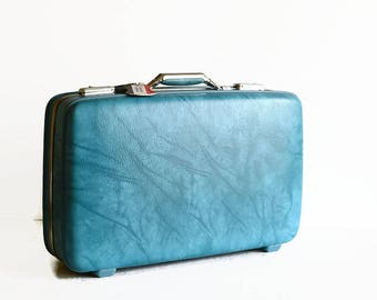 vintage marble blue suitcase with key American Tourister travel luggage