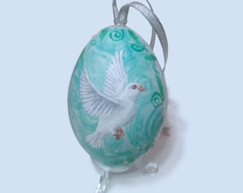 Painted Easter egg ornament. Original painting of two white doves, with a turquoise blue / aqua background, on the shell of a real goose egg