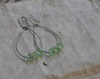 Sterling silver hammered drop earrings with green cut glass beads, hand forged, unique