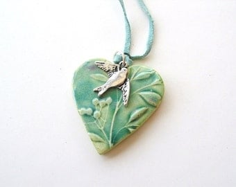 Heart pendant Spring green turquoise glaze swallow seafoam suede