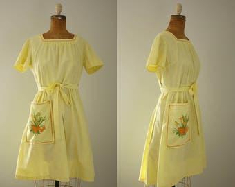 1950s Swirl wrap dress | vintage 50s yellow apron dress
