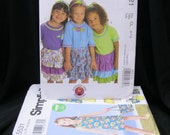 Lot of 8 Girl's Patterns in sizes 3 - 8, NOS, McCall's 5569, 6021, 5837, 5839, 5918, Simplicity 5531, 0439, and 2767, dresses, skirts, pants