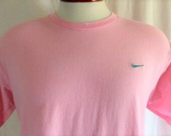 vintage 90's Nike solid pastel pink embroidered green swoosh crew neck t-shirt men women unisex  minimalist large