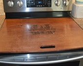 Two custom engraved stove toppers.