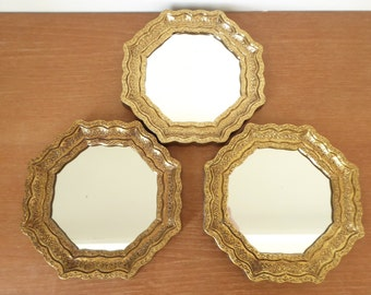 Three small gold octagonal accent mirrors, florentine style