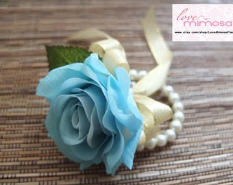 Wrist Corsage, Light Blue rose with gold organza on pearl bracelet