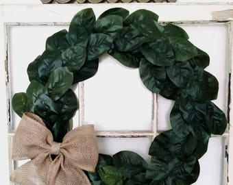 Magnolia wreath with large burlap bow