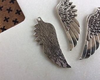 Antique silver wing charm pendants
