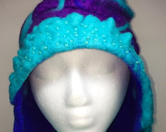 Purple and turquoise wet felted hat with curl, rings and stars