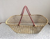 Vintage wire shopping basket with red handles