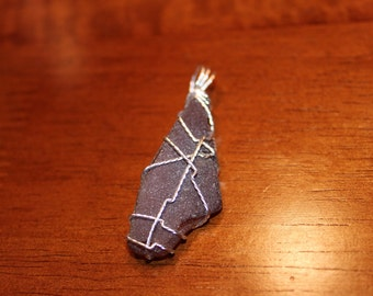 Textured wire wrapped brown sea glass pendant