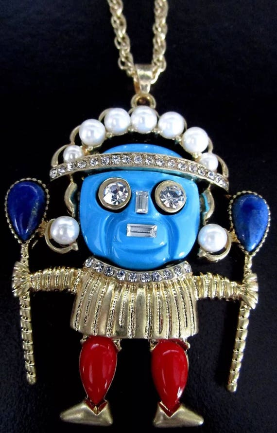 Vintage unsigned designer Tiki Voodoo God Warrior Pendant adorned with faux pearls rhinestones with blue & purplish red lucite on chain