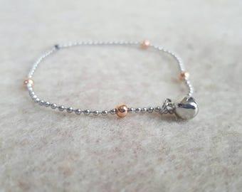 Silver bracelet, ball chain, tiny bell charm.