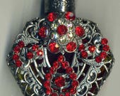 Bohemia Glass Perfume Bottle - red glass silver filigree bow with red and iridescent stones PB 412