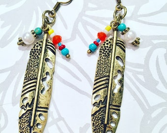 Vintage bronze feathers with delicate beaded accents.