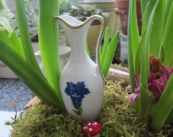 blue flowers of the gentian, small vase from the Bavarian Alps, shabby chic from the fifties